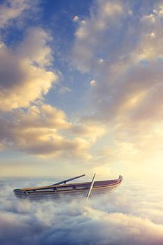Empty rowboat above clouds