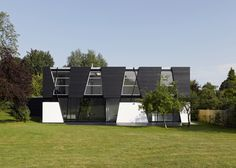 Daring Geometry: Black And White House in Kent Sliced Up Into Irregular Shapes #architecture
