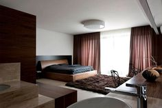 Trendy Functional and Contemporary Home dark draperies soft rugs bedroom