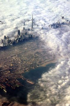 Dubai in the clouds #city #desert #clouds #dubai #skyscraper #photohgraphy