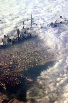 Dubai in the clouds #dubai #clouds #city #skyscraper #desert #photohgraphy