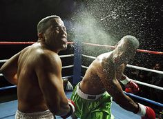 Heavyweight boxer landing right hook on opponent's jaw