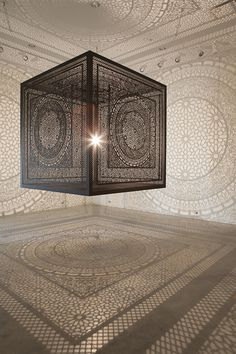Intersections: An Ornately Carved Wood Cube Projects Shadows onto Gallery WallsFebruary 3 #wood #ornate #carved #shadows