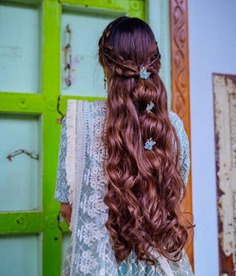 Three Knots Hairstyle For Long Hair