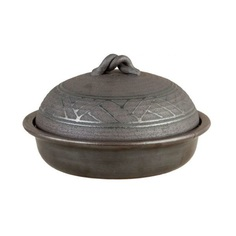 Smoke Pot Donabe The Smoke Donabe Pot is a versatile Japanese hot pot that allows you to steam, bake, and grill! It is a three-in-one pot made out of heat-resistant ceramic clay. It's suitable for use over direct fire, and in the microwave, oven, and dishwasher. Carefully crafted in Japan.