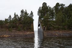 jonas dahlberg slices memory wound into utoya island in norway #norway #slice #island #memorials #trees