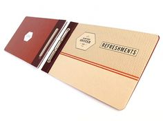 Art of the Menu: Island Creek Oyster Bar #maroon #ivory #menu #orange #black #crest #seal #collateral