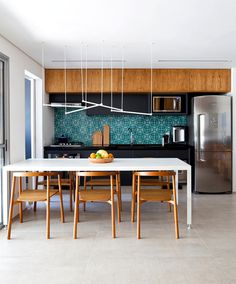 Metamoorfose Studio Cleverly Arranged Space at Sao Paulo Apartment - InteriorZine