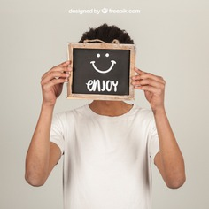 Man holding slate in front of face Free Psd. See more inspiration related to Mockup, Template, Man, Quote, Face, Smile, Happy, Presentation, Chalkboard, Mock up, Boy, Chalk, Drawing, Young, Up, Happy face, Guy, Holding, Showcase, Stylish, Slate, Smiling, Front, Mock, Joyful, Presenting and Showing on Freepik.