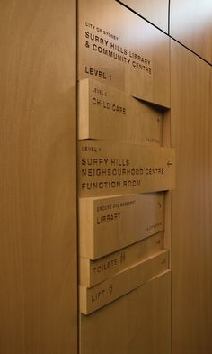 Wood signage, shifting panels, wood burned/engraved names lobby directory Sydney library and community center #burnedengraved #lobby #shifting #center #sydney #community #wood #directory #panels #library #signage #names