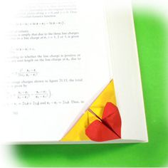 How to make a bottom-corner heart origami bookmark (http://www.origami-make.org/howto-origami-bookmark.php)