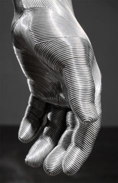 Meticulously Wrapped Aluminum Wire Sculptures by Seung Mo Park #layers #wrapped #sculpture #silver #design #fingers #wire #art #thumb #metal #hand #aluminium