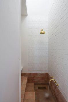 Bath area with sunken terracotta tub. Casa Modesta by PAr. © João Carmo Simões. #bathroom #terracotta #bathtub