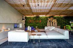 Tropical Loft Designed by Gisele Taranto Arquitetura lush green wall ferns #decor #home decor #interior #interior design #green wall