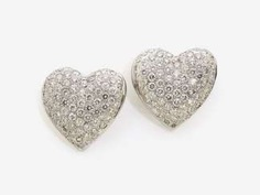 A PAIR OF HEART SHAPED STUD PIN PLUG DECORATED WITH BRILLIANT-CUT DIAMONDS