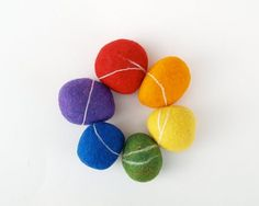 Rainbow Felted Stones Gorgeously Bright and Colorful by Fairyfolk #felt #rainbow #stone