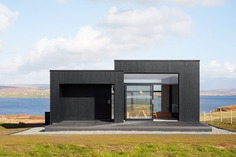 Modern Vacation Cabin Modeled on Traditional Scottish Longhouses