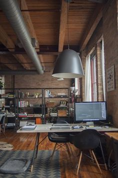 Nicole & Mike's Warm Industrial Loft — House Call | Apartment Therapy #apartment #office #desk #space