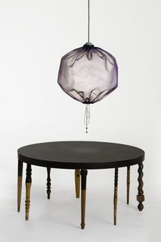 Drawstring Lamp and Odd Table by Merry Go Round/ Design Stories, photo by Hendrik Zeitler #table