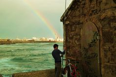 Cadizzle 2011 on Behance #spain #wallb #fisherman #cadiz #rainbow