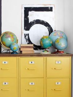 Three filing cabinets spray-painted yellow and topped with plywood #cabinet