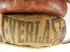vintage antique old Everlast boxing gloves stuffed with horsehair