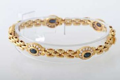 Bracelet yellow gold 18 K with 5 oval fac. Safiren approximately 2.5 cts, and 60 Brill. together. of 1.42 cts, TW-W / vsi-si.