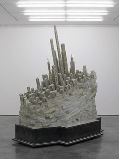 Books Sculpted into an Abandoned City by Liu-Wei