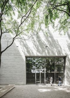 Massive gray brick wall. Kolumba Museum by Peter Zumthor. © COAST Studio. #courtyard #brick