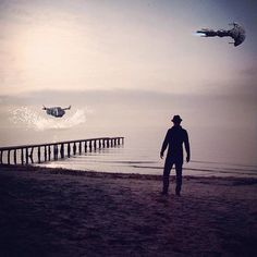 Man Looking At Space Ships Over Sea
