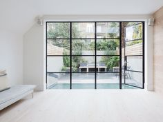 Steel framed glass door. Fulham House by Daniel Lee. #door #window #minimal