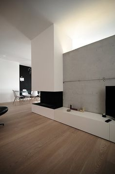 house SD, Rosà Rosa', 2012 #interior #concrete #home #wood #fireplace #eames