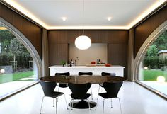 Symmetrical Tripartite Villa Moerkensheide wooden wall paneling living space #interior #kitchen #design