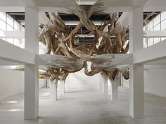 Architectural Columns at the Palais de Tokyo Explode into Organic Forms #installation #nature #architecture #art #contrast
