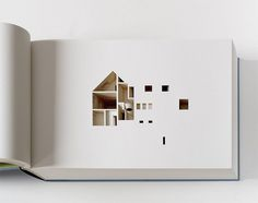 The Negative Space of a House Cut Inside a 908 Page Book #negative #building #book #space