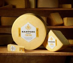 Sartori - TheDieline.com - Package Design Blog #white #label #crest #seal #gold #logo