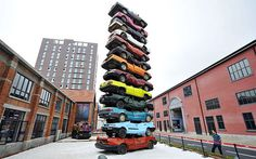 CJWHO ™ (A sculpture made of 13 retired cars in 'Jiangcheng...) #wuhan #sculpture #design #cars #china #art #jiangcheng