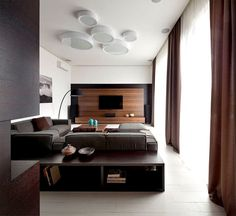 Trendy Functional and Contemporary Home fashionable moody dark living room interior 4