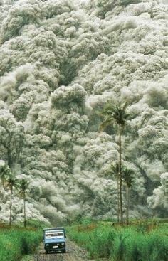 Roiling clouds of superheated ash surge from Mount Pinatubo in the PhilippinesNational Geographic | December 1992 #photography #clouds #phil