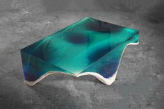 Bring the Ocean to Your Living Room With the delMare Table A mesmerizing piece made of blue and green marble and acrylic glass.
