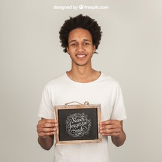 Smiling man presenting slate Free Psd. See more inspiration related to Mockup, Template, Man, Quote, Face, Smile, Happy, Presentation, Chalkboard, Mock up, Boy, Chalk, Drawing, Young, Up, Happy face, Guy, Holding, Showcase, Stylish, Slate, Smiling, Mock, Joyful, Presenting and Showing on Freepik.