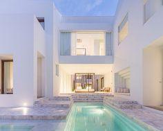 onion sala ayutthaya boutique hotel curved brick walls white geometries thailand designboom #pool