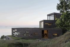 Four Stacked Boxes Defining Modern Family House in San Juan Island