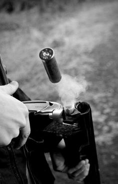 outdoors and old timey / #white #smoke #gun #motion #shell #black #stop #and #bullet #shotgun #unload #casing