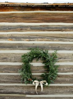 diy holiday wreath tutorial #wreath #christmas #wood #cabin #bow #green