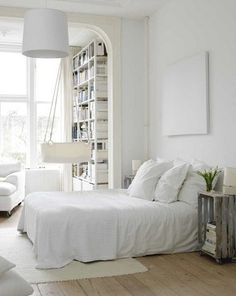 clean, natural light, bookcase #interior #design #white #bedroom
