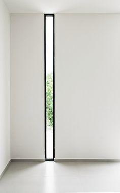Floor-to-ceiling narrow window. W41 by Warm Architects. Photo by Zaruhy Sangochian. #window #warmarchitects #narrowwindow #floortoceilingwin