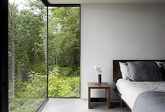Bedroom with floor-to-ceiling windows. Case Inlet Retreat by Mw|works. © Jeremy Bittermann. #bedroom