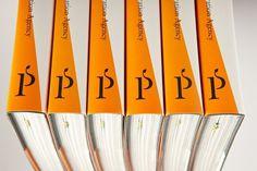 Pirum Press — book blog #spine #orange #book #press #identity #pirum #logo