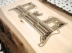 grayhood » Blog Archive » wood burned e - dan gneiding graphic design